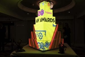 6 foot AV Magazine awards cake.This was a beast of a cake half projection and half sugar crafted. The crafted side had all cogs and pipes and a massive 20 all crafted from chocolate with the logo of Epson. everything is airbrushed and we went on the design from the invitation that was sent out. The 2 foot 3D scalped man called Gizmo was drawn up by the clients on paper in 2D from that image we created a 3D version of him in high detail.