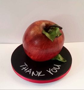 Apple for the teacher , this cake is all vanilla sponge with jam, hand carved and airbrushed.