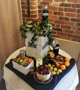 A continually pouring shabby chic sloe Gin wedding cake. All leaves and sloe berries are hand crafted painted and dusted with a mixture of sugar grape vines requested by the bride. We had two pouring spouts from this cake and the little cake at the front to fool people into thinking that was the cake until they cut up the create.