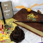 Working harry potter cake with and light up chocolate wand, Rice crispy treat sorting hat, chocolate snitch and frog, edible bertie botts beans and a magical chocolate tom riddles diary.