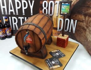 Working beer barrel cake, this cake held 1 litre of beer which also fed 40 people. Included was a light up sign of the brewery with edible beer mats.